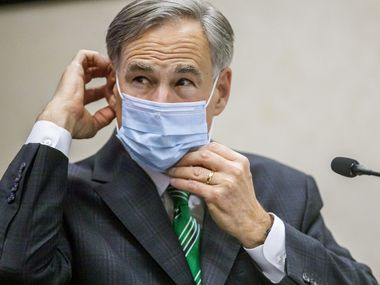 Gov. Greg Abbott, shown adjusting his mask at an Austin event last month, is touting a Fort Worth researcher's new study as evidence that mask orders are putting a dent in Texas' recent surge in coronavirus infections -- and may be sufficient to avoid another shutdown. But the study has limitations.